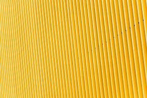 Detail of yellow metal building faca