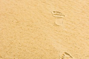 Human footprints on the sand