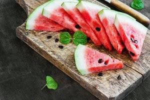 Fresh sliced watermelon on an old