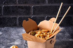 Box with  noodles and fortune cookie