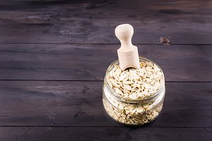 Oat flakes  in glass jar and wooden