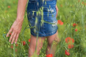 Woman enjoying a walk in a poppy