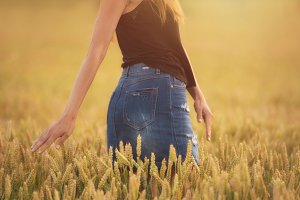Woman enjoy sunset in wheat field