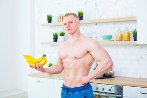 Muscular man with a naked torso in