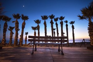 Shilouette of park bench at sunset