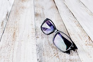 black glasses on wooden background