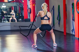 Woman training with battle rope in