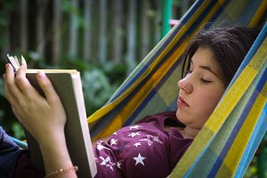 introvert teenager girl reading book