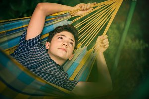 teenager boy resting in hammock