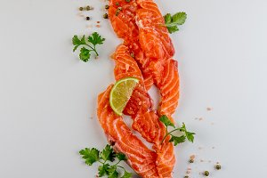 Fresh salmon slices and spices on