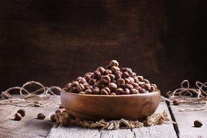 Peeled hazelnuts, vintage wooden bac