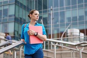 Girl holding folder for documents
