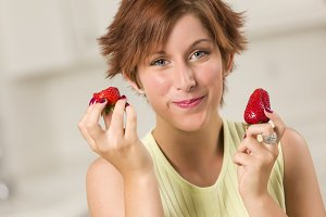 Pretty Red Haired Woman Eating Straw
