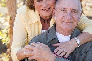 Senior Woman with Man Wearing Oxygen