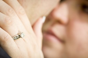 Female Hand with Engagement Ring Tou