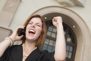 Young Businesswoman with Fist in Air