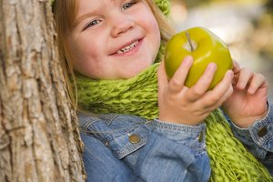 Young Girl Wearing Green Scarf and H