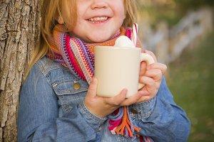 Cute Young Girl Holding Cocoa Mug wi