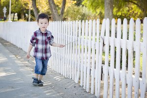 Young Mixed Race Boy Walking with St