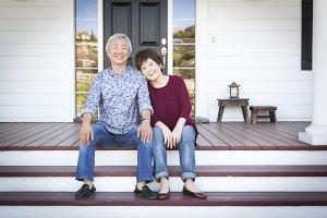 Senior Chinese Couple Sitting on Fro