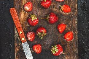 fresh juicy strawberries wooden boar