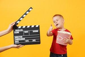 Fun kid baby boy showing thumbs up h