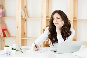 Worried Young Business woman Working