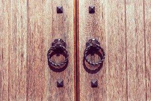 wooden door with forged handles