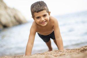 Little boy doing exercise