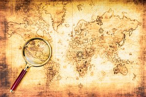 Old map with an magnifying glass