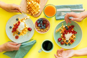 Breakfast with waffles, wipped cream