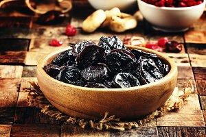 Dried sweet prunes or dark plums in
