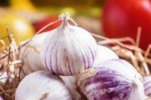 Small fresh garlic in a bowl. Vintag