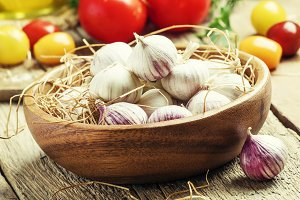 Small fresh garlic in a bowl. Vintag