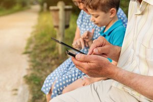 Grandfather hands using smartphone a