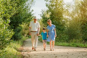 Grandparents and grandchild walking