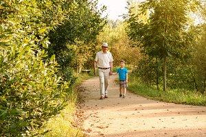 Grandfather and grandchild walking o