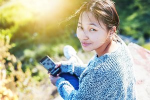 Asian teen girl with smartphone