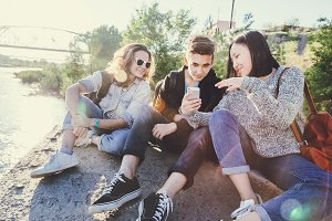 Teen friends with smartphone