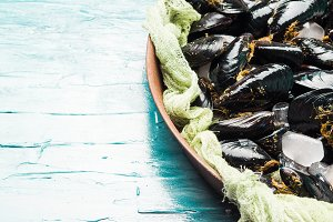 Fresh raw mussels on rusty tray