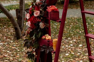 Wedding arch in Golden-red tones
