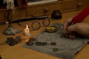 Adventurer drawing a map