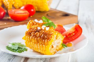 Pieces of sweet corn grilled in tin