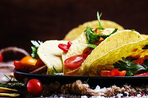 Mexican tacos stuffed with meat, bea