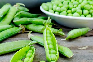 Pods of young green peas and pea