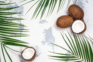Coconut halves and leaves