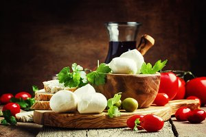 Mozzarella cheese, bread, olives and