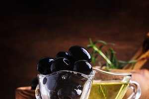 Black olives, wood background, selec
