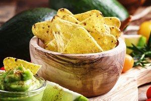 Corn nachos with salt in wooden bowl