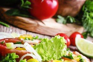 Salad with avocado, salmon, lettuce,